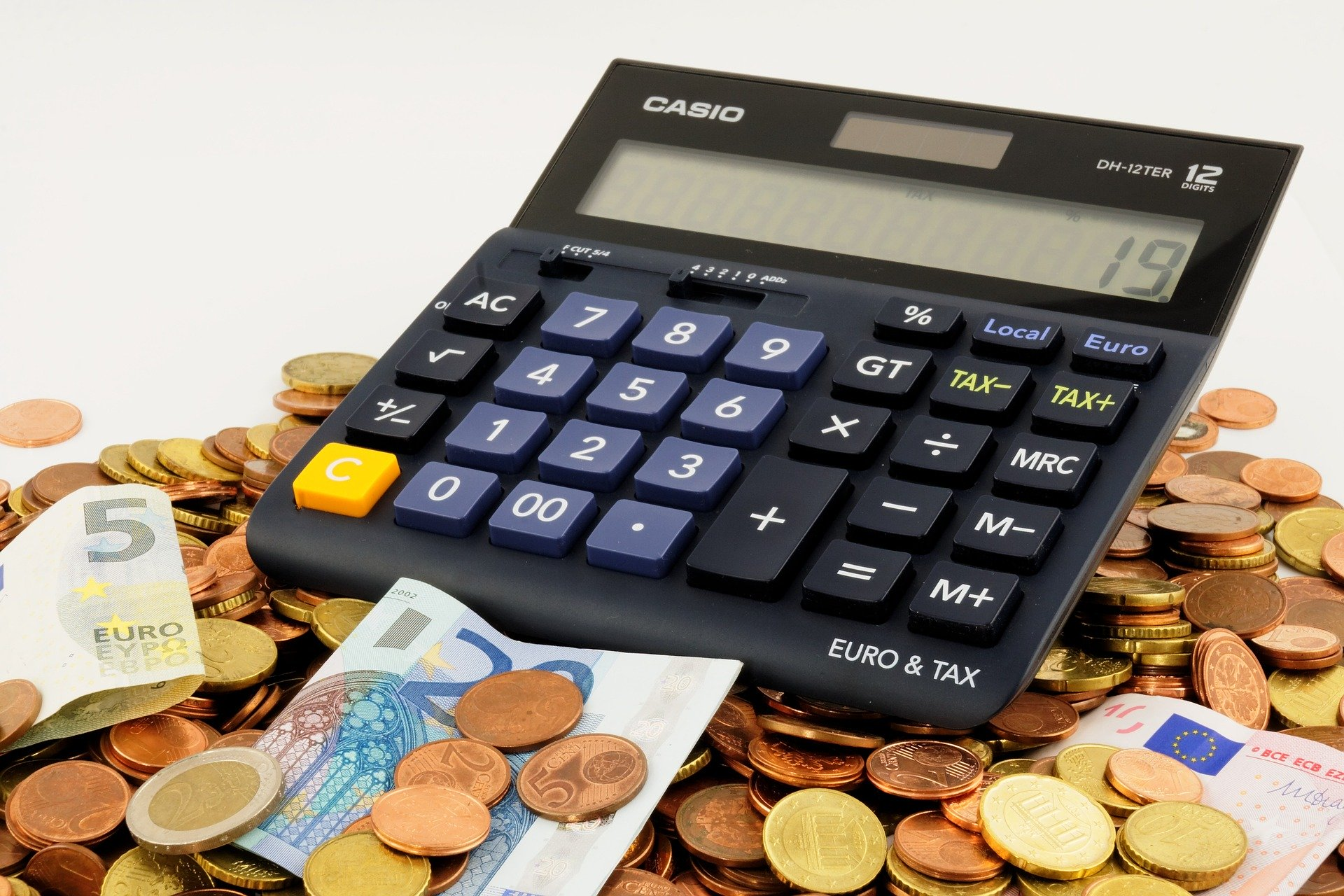 Calculator, cash and coins