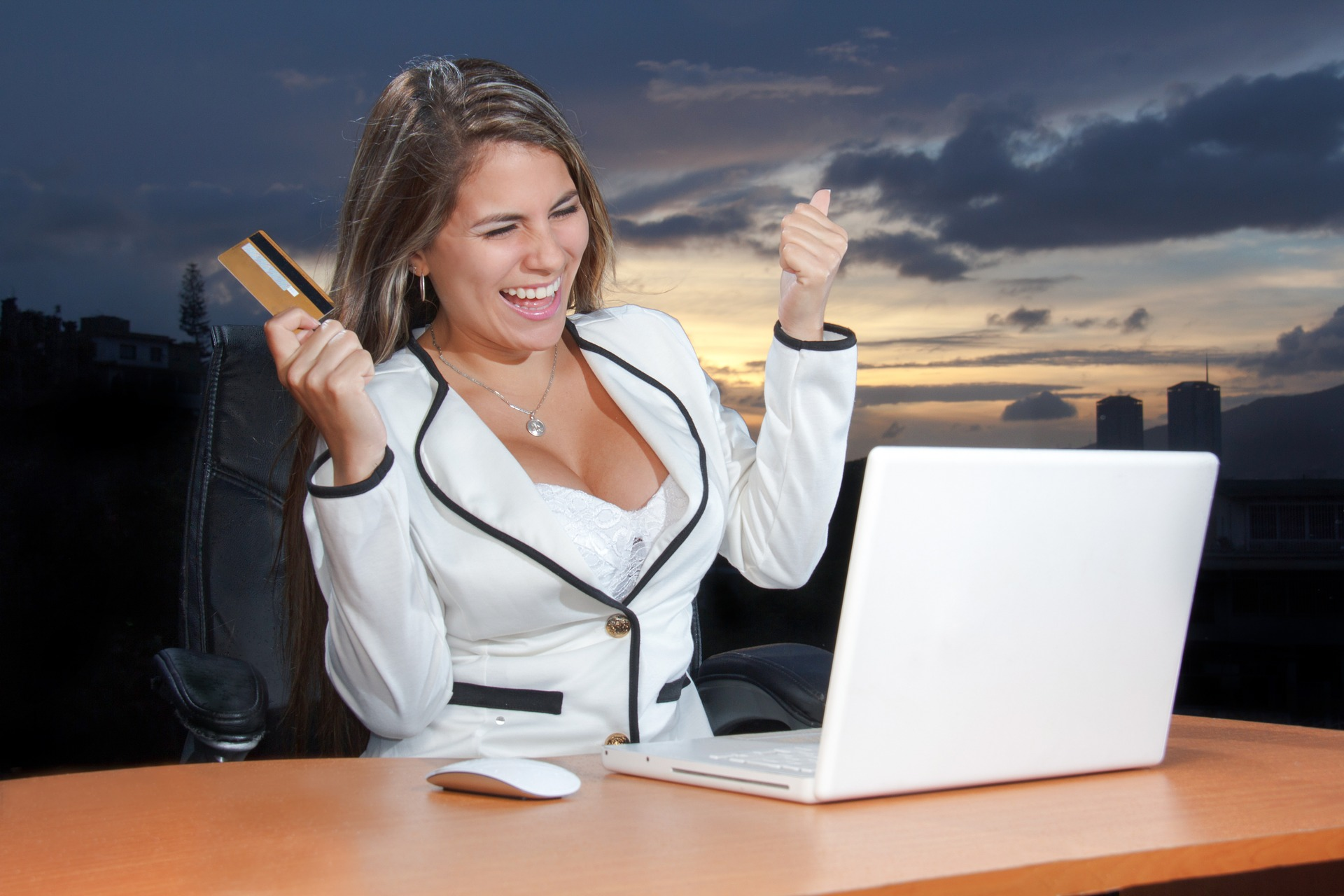 Happy woman with a credit card